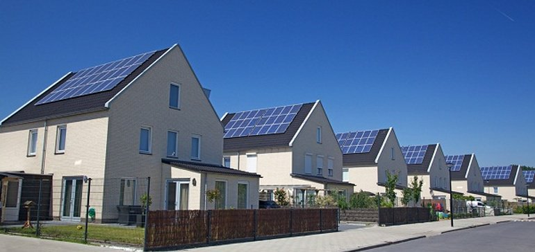 Photo of roof mounted solar on identical houses