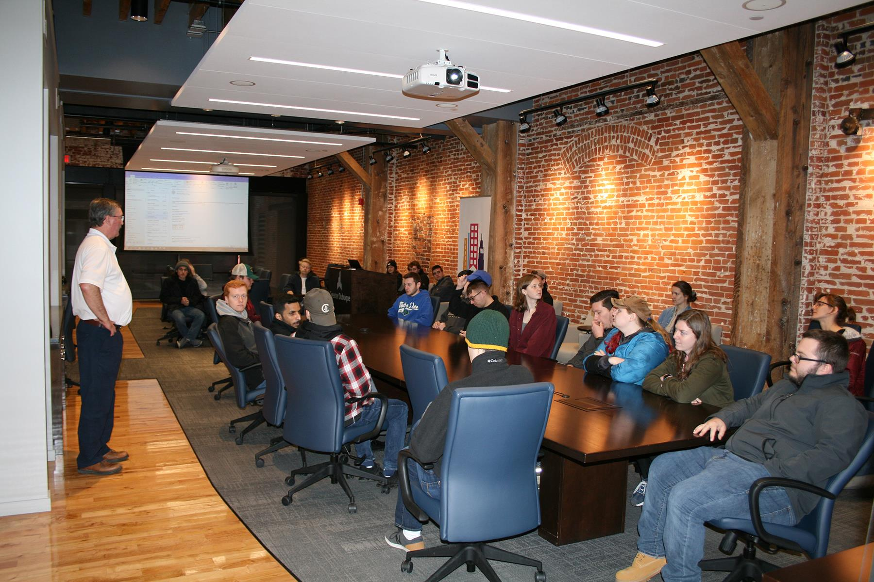 Photo of UW Plateville students at Eagle Point Solar Headquarters learning about solar energy