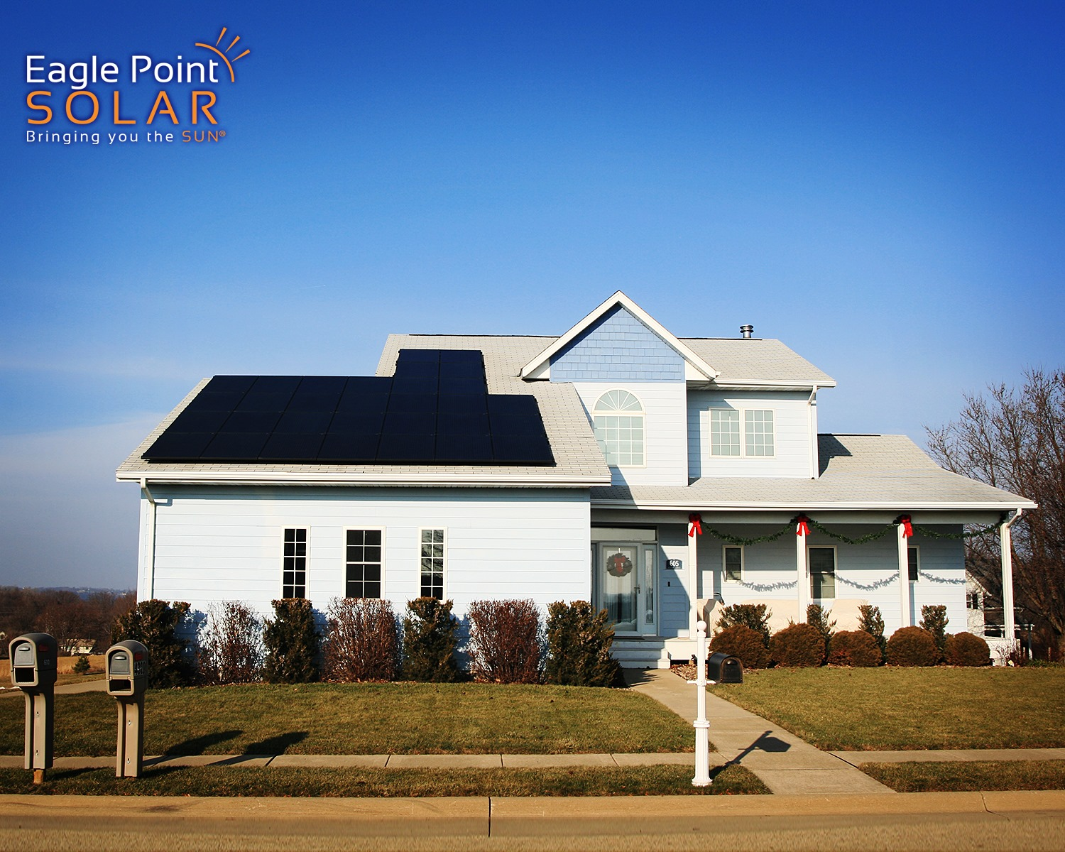 Photo of residential roof mounted solar array with black panels