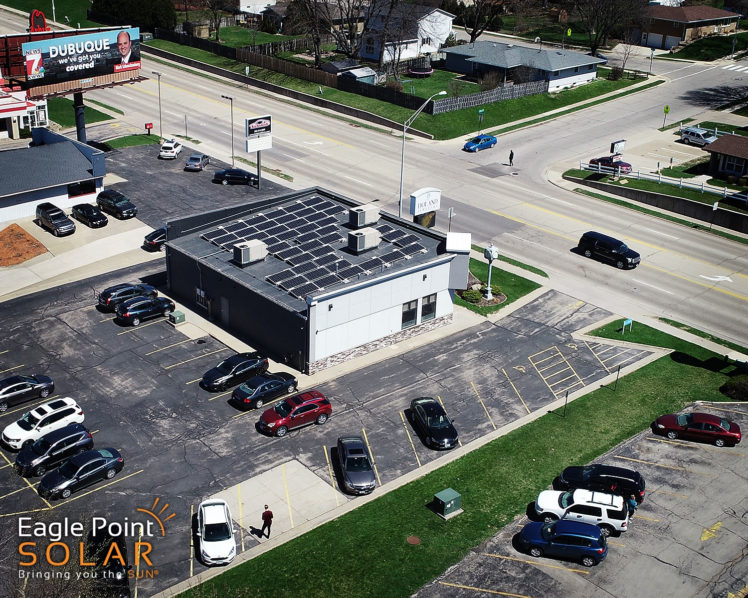 Photo of commercial roof mounted solar array on Doland Jewlers