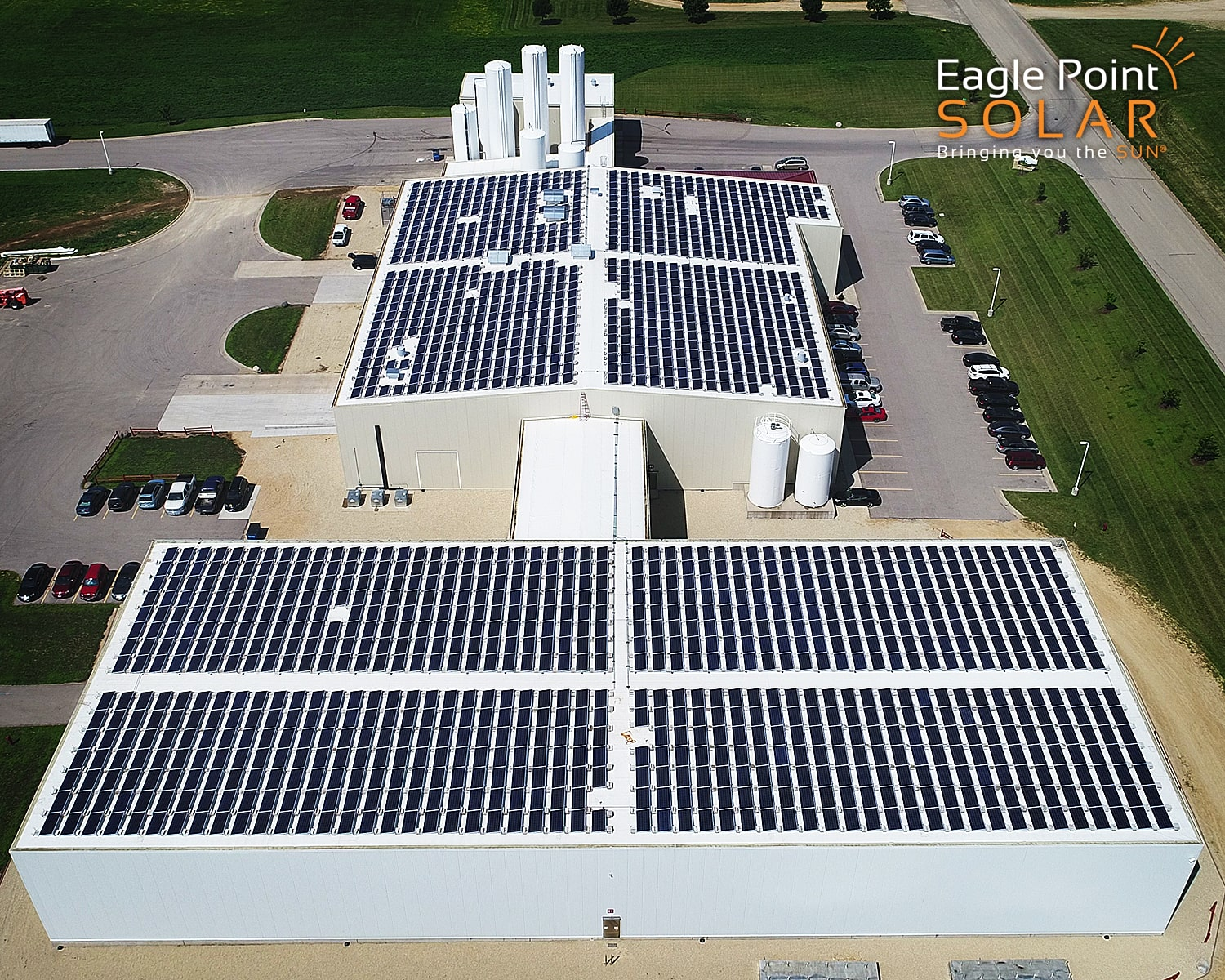 Photo of commercial roof mounted solar array on Emmi roth