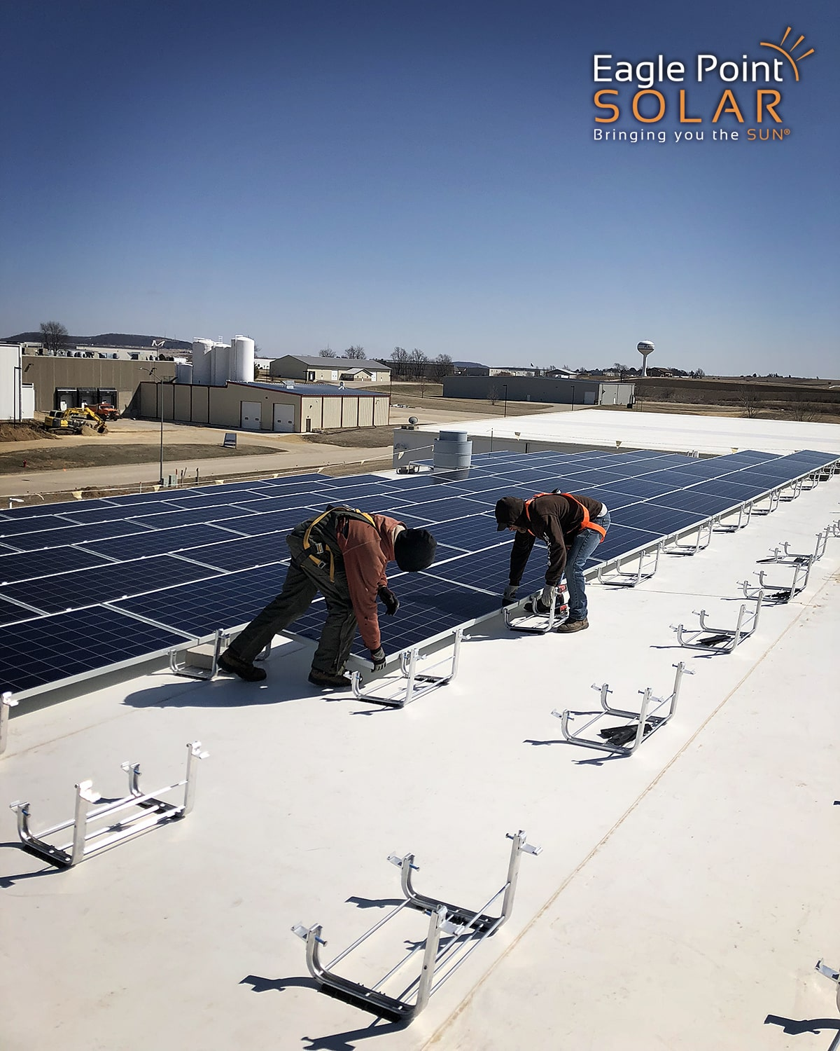 Photo of roof mounted solar array being installed