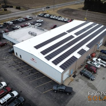 Photo of commercial roof mounted solar array on Essig Motors