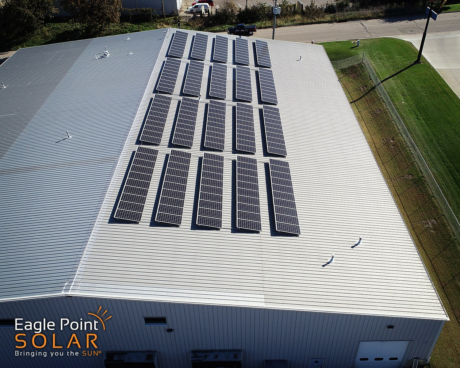 Photo of commercial roof mounted solar array on Harris Golf Cars