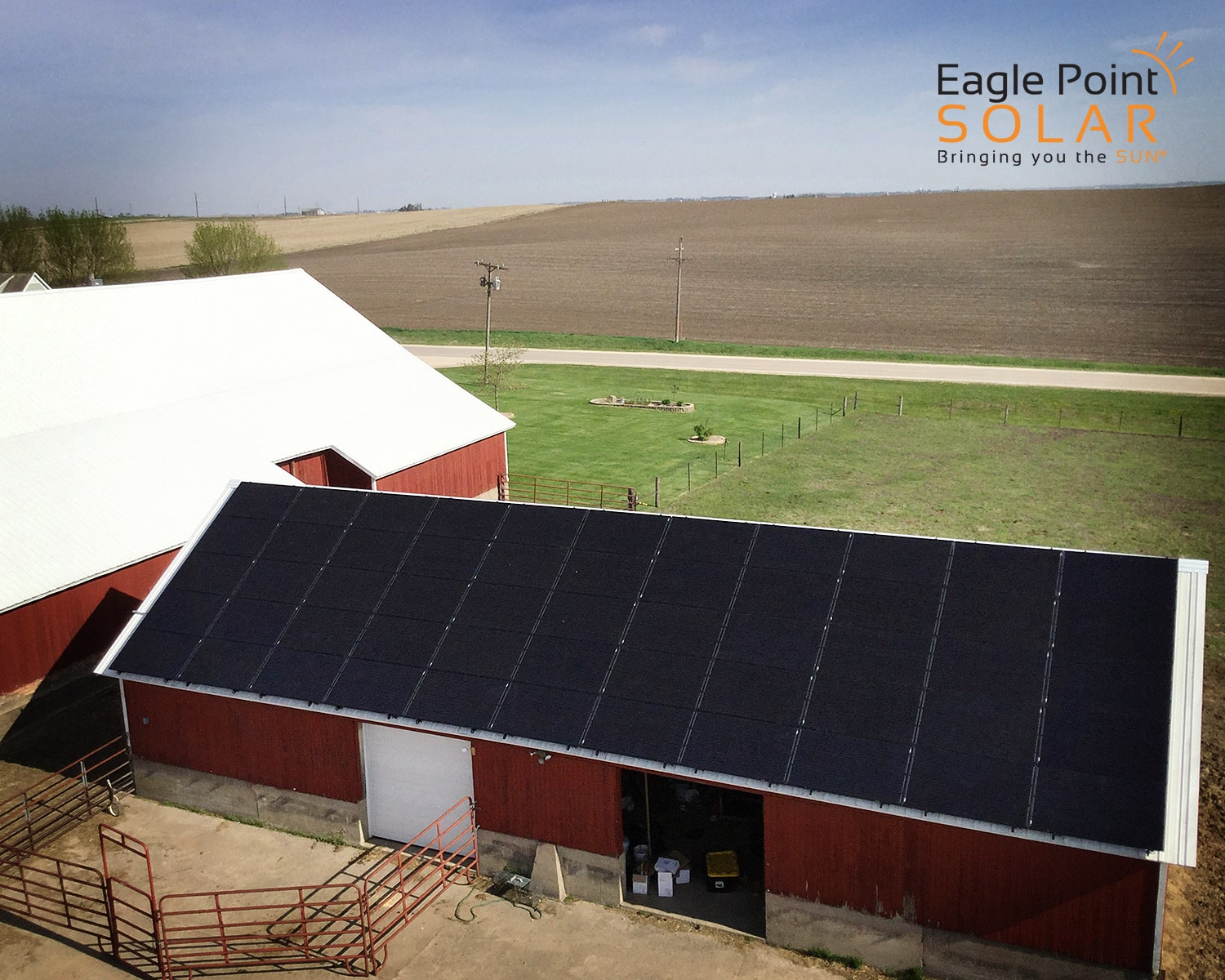 Photo of a roof mounted solar array with all black panels