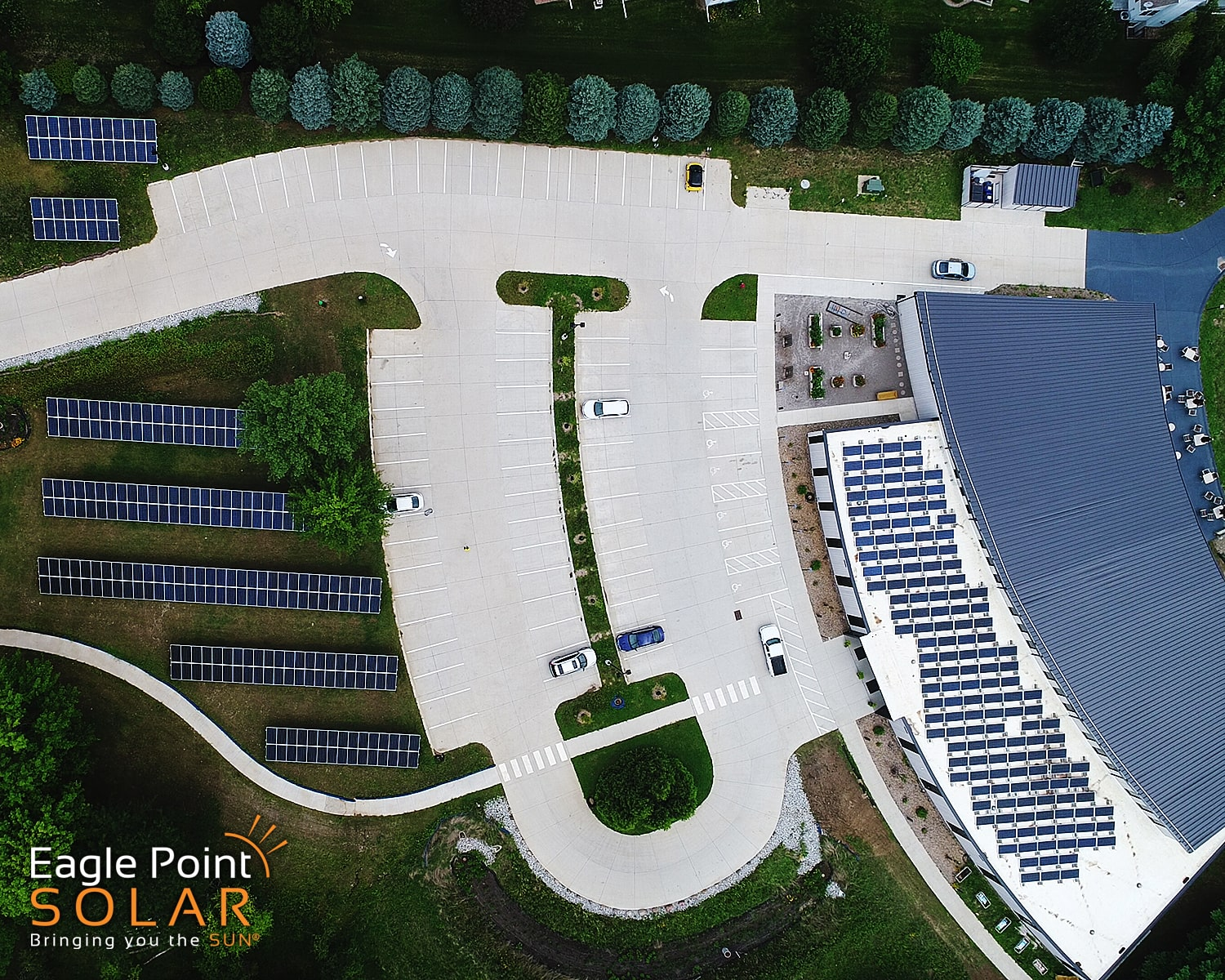 Overhead photo of Unitarian roof and ground mounted solar array