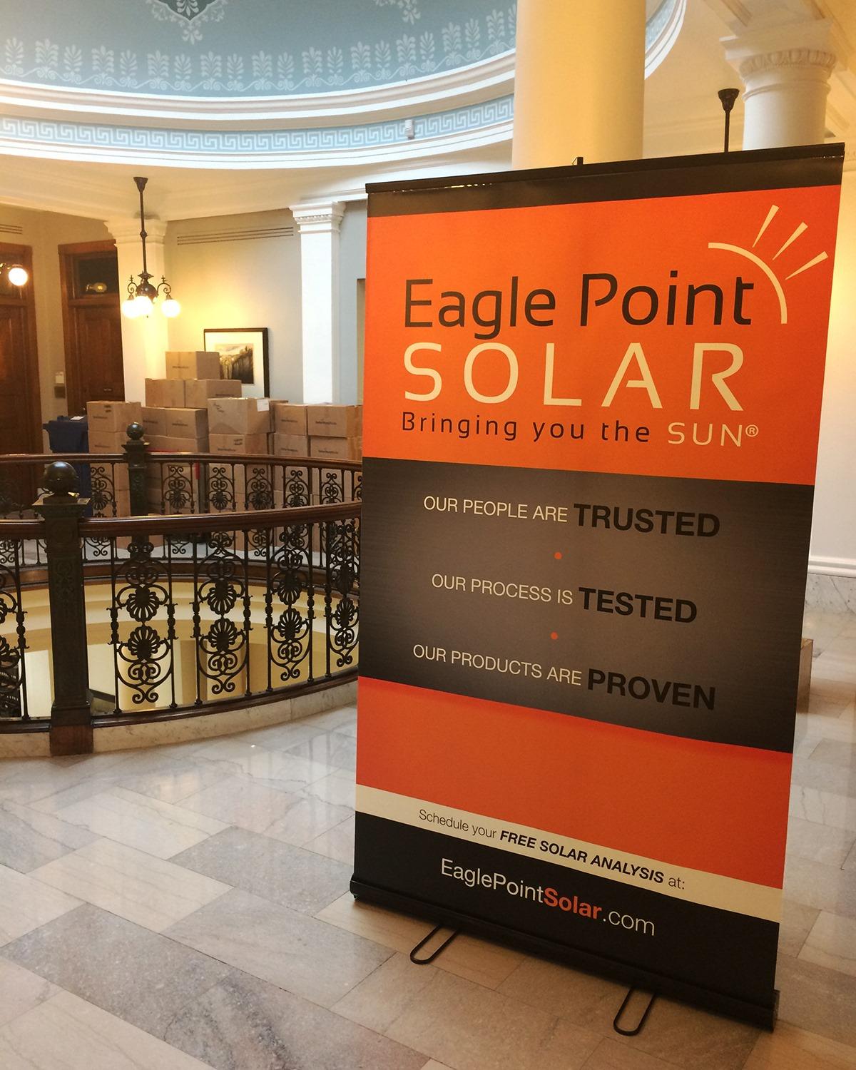 Photo of Eagle Point Solar banner outside the room of a solar energy educational seminar