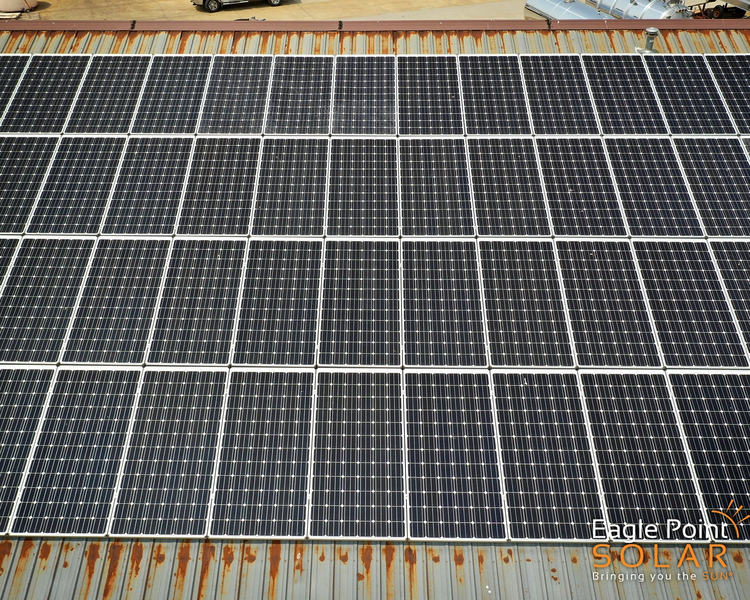 Close up photo of commercial roof mounted solar array on Advance Pump