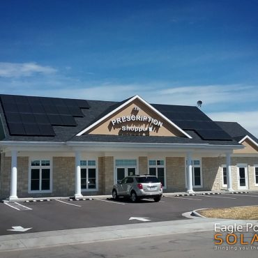 Photo of commercial roof mounted solar array on The Prescription Shoppe