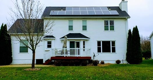 Photo of a residential home with solar mounted on the roof