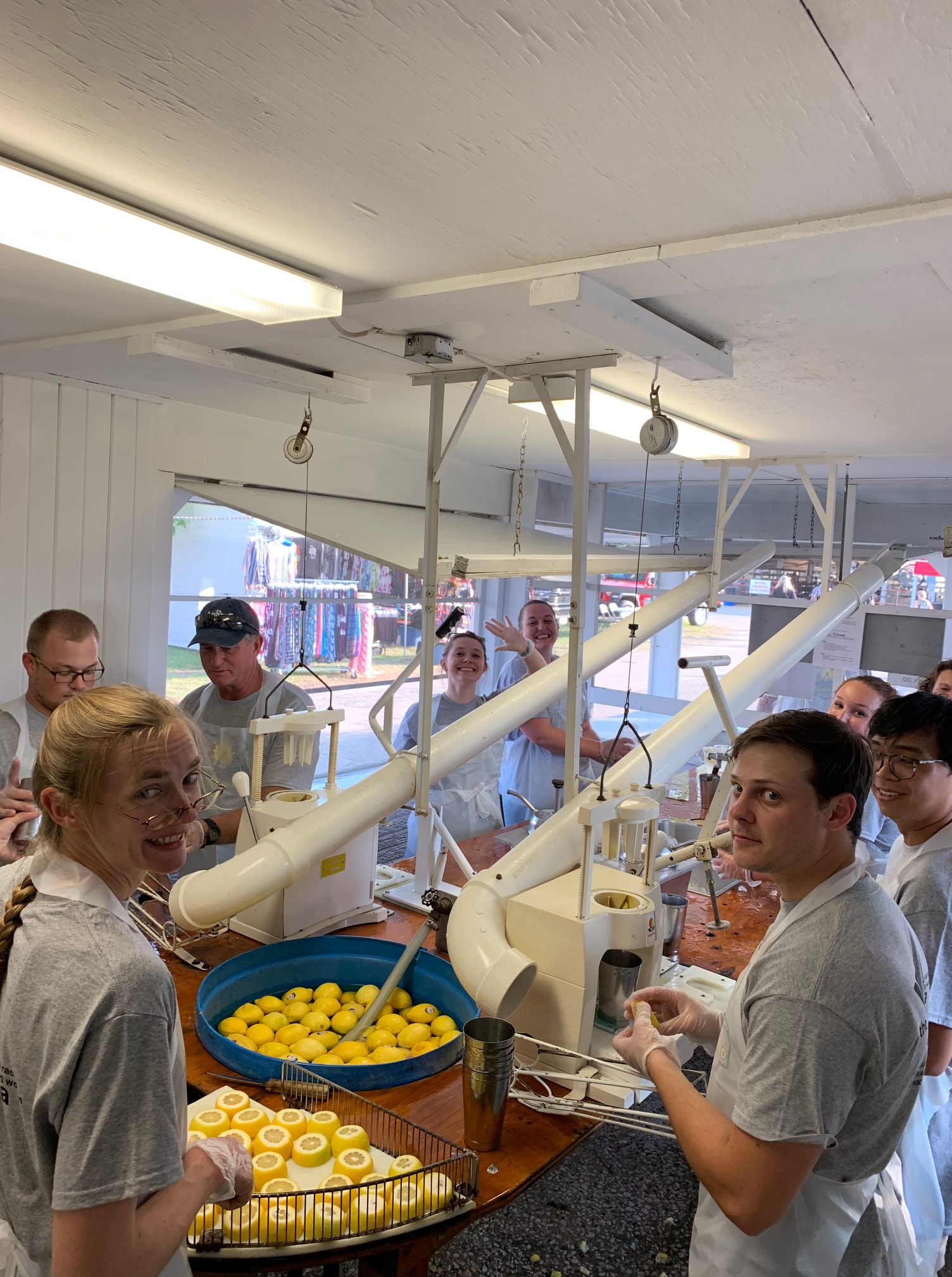 Photo of Eagle Point Solar employees volunteering at the County fair for the YMCA