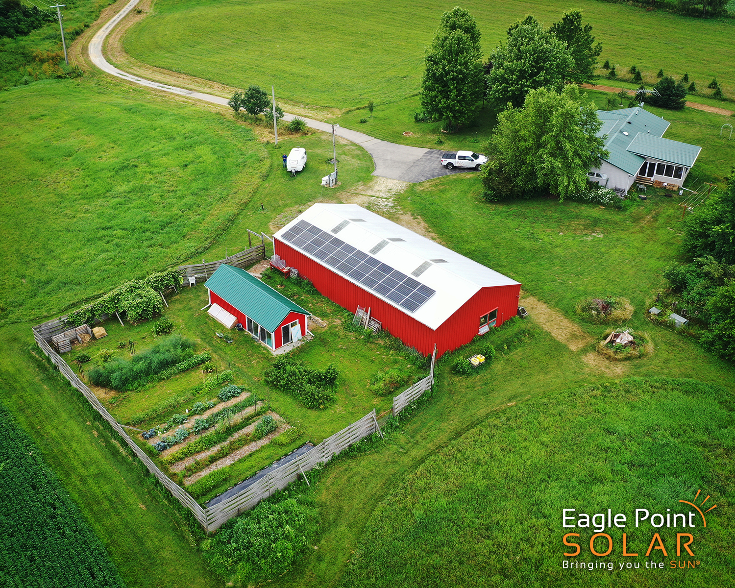 Arial photo of roof mounted solar array on small farm shed.