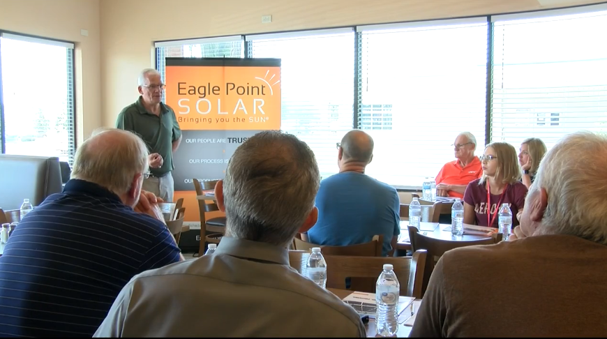 Photo of Larry Steffen giving a presentation at a Solar Energy Lunch & Learn in Peoria, IA